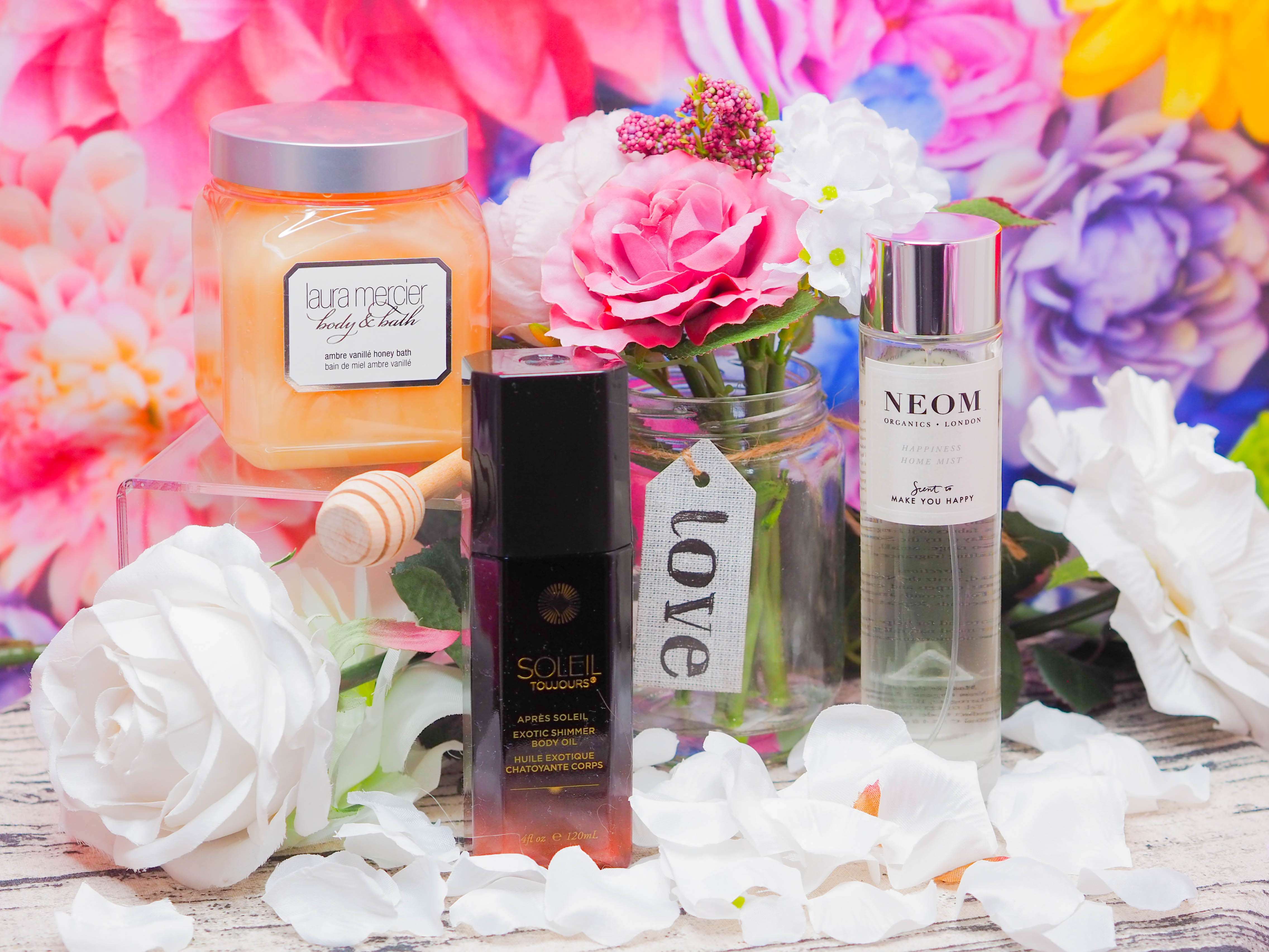 Three luxury beauty products from Laura Mercier, Neom and Soleil Toujours